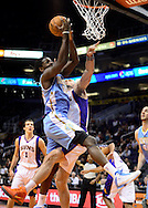 Nov. 12, 2012; Phoenix, AZ, USA; Denver Nuggets forward Kenneth Faried (35) drives the ball against the Phoenix Suns center Marcin Gortat (4) during the first half at US Airways Center. The Suns defeated the Nuggets 110-100. Mandatory Credit: Jennifer Stewart-US PRESSWIRE