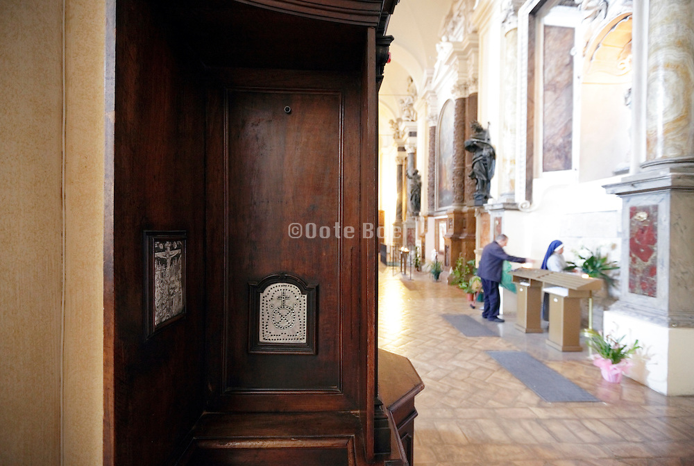 confessional in church side aisle Italy