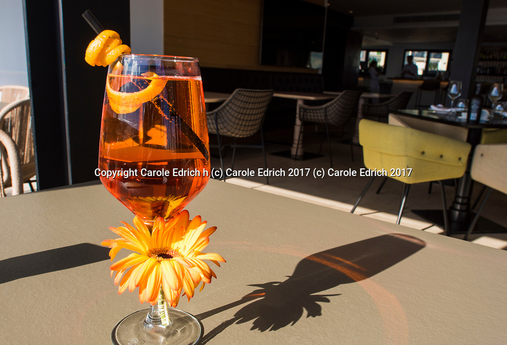 Aperol spritz with twist of orange and gerbera flower and shadow at Cuit Restaurant, Nakar Hotel. (c) Carole Edrich 2017