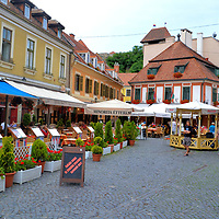Outdoor Restaurants at Dob&oacute; Square in Eger, Hungary <br /> This corner of Dob&oacute; Square features boutique hotels and quaint eateries. While having a meal outdoors, enjoy the local red wine called Egri Bikav&eacute;r or Bull&rsquo;s Blood of Eger. This main plaza of Eger is uncrowded and charming except for special events and festivals. Flanking Dob&oacute; ter are several 18th century Baroque landmarks including the Minorite Church.