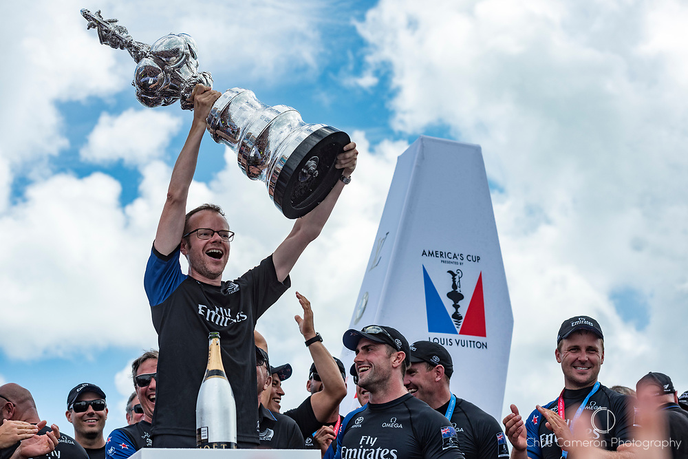 The America's Cup Village, Bermuda, 26th June 2017. Emirates Team New Zealand Technical Director, Dan Bernasconi with the America's Cup.
