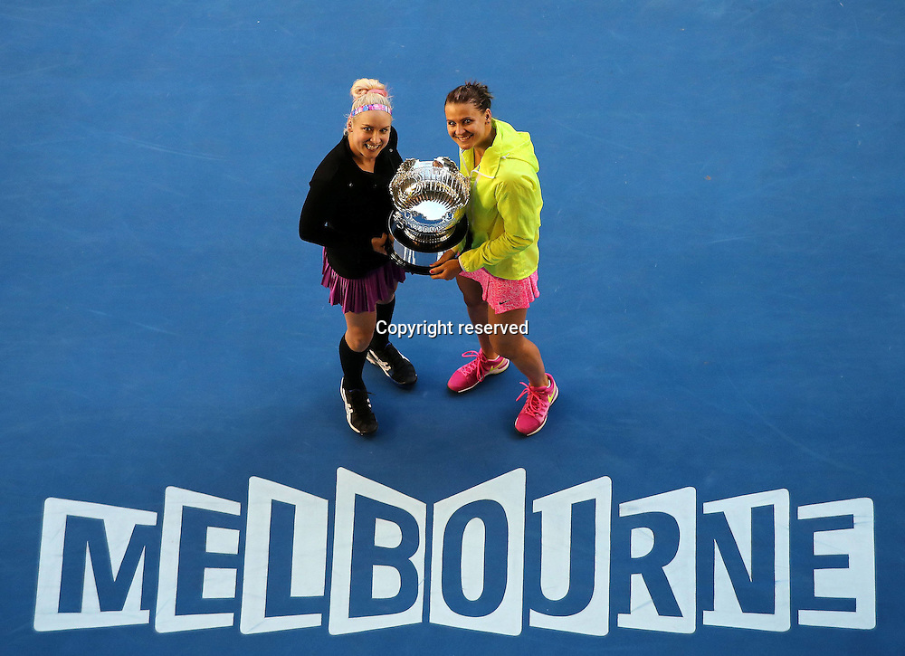 30.01.2014. Melbourne, Australia.  Bethanie Mattek-Sands (L) of the U.S.and Lucie Safarova of the Czech Republic celebrate after winning their womens doubles final at the 2015 Australian Open tennis tournament at Melbourne Park in Melbourne, Australia, Jan. 30, 2015.