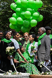 London, UK. 14 June, 2019. Emma Dent Coad, Labour MP for Kensington, joins family members to release doves of peace following a memorial service at St Helen's Church to mark the second anniversary of the Grenfell Tower fire on 14th June 2017 in which 72 people died and over 70 were injured.