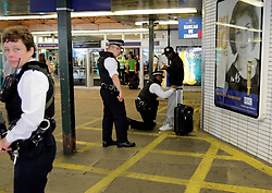 UK ENGLAND LONDON 28JUL05 - British Anti-Terrorist Police search a suspect man at the entrance to Kings Cross station in central London following two terrorist attacks in the past three weeks...jre/Photo by Jiri Rezac ..© Jiri Rezac 2005..Contact: +44 (0) 7050 110 417.Mobile:  +44 (0) 7801 337 683.Office:  +44 (0) 20 8968 9635..Email:   jiri@jirirezac.com.Web:    www.jirirezac.com..© All images Jiri Rezac 2005 - All rights reserved.