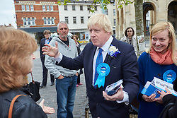 © Licensed to London News Pictures.  02/05/2015. ABINGDON, UK. Boris Johnson (centre) talks to voters while campaigning in Abingdon with Nicola Blackwood (right in blue coat) who is standing for re-election as MP for the Oxford West and Abingdon constituency. Photo credit: Cliff Hide/LNP