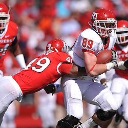 Apr 24, 2010; Piscataway, NJ, USA; Scarlet linebacker Al-Ghaffaar Lane (49) hits White tight end Paul Carrezola (89) during Rutgers Scarlet and White intersquad NCAA football scrimmage at Rutgers Stadium. The Scarlet squad defeated the White, 16-7.