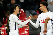 Son Heung-Min of Tottenham Hotspur (7) and Dele Alli of Tottenham Hotspur (20)  celebrating after scoring goal to make it 2-0 during the Premier League match between Tottenham Hotspur and Brighton and Hove Albion at Wembley Stadium, London, England on 13 December 2017. Photo by Matthew Redman.