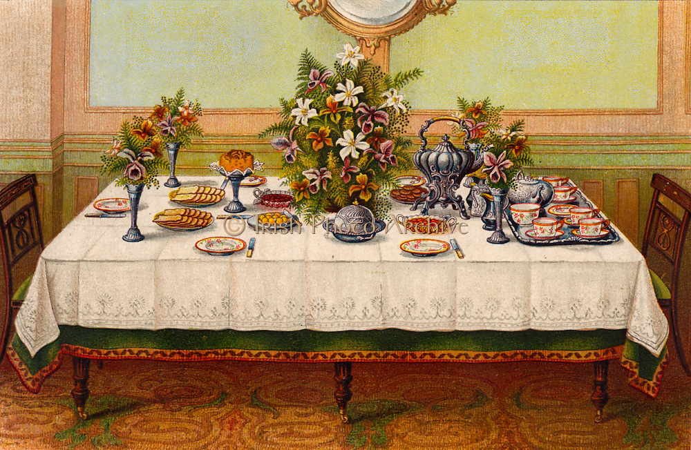 Table covered with a linen cloth and set for Afternoon Tea.  A tea kettle on a stand with a spirit heater under it is placed near the teapot.  Oleograph from 'Household Management' by Isabella Beeton (London, 1906).