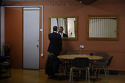 "© London News Pictures. ""Looking for Nigel"". A body of work by photographer Mary Turner, studying UKIP leader Nigel Farage and his followers throughout the 2015 election campaign. PICTURE SHOWS - NIgel Farage rehearses his speech before a large public meeting, in a private room at the Carn Brae Leisure Centre in Penzance, Cornwall, on March 6th 2015. Mr Farage spent a long weekend in the South West speaking to the more elderly population in Cornwall and Devon. . Photo credit: Mary Turner/LNP **PLEASE CALL TO ARRANGE FEE** **More images available on request**"