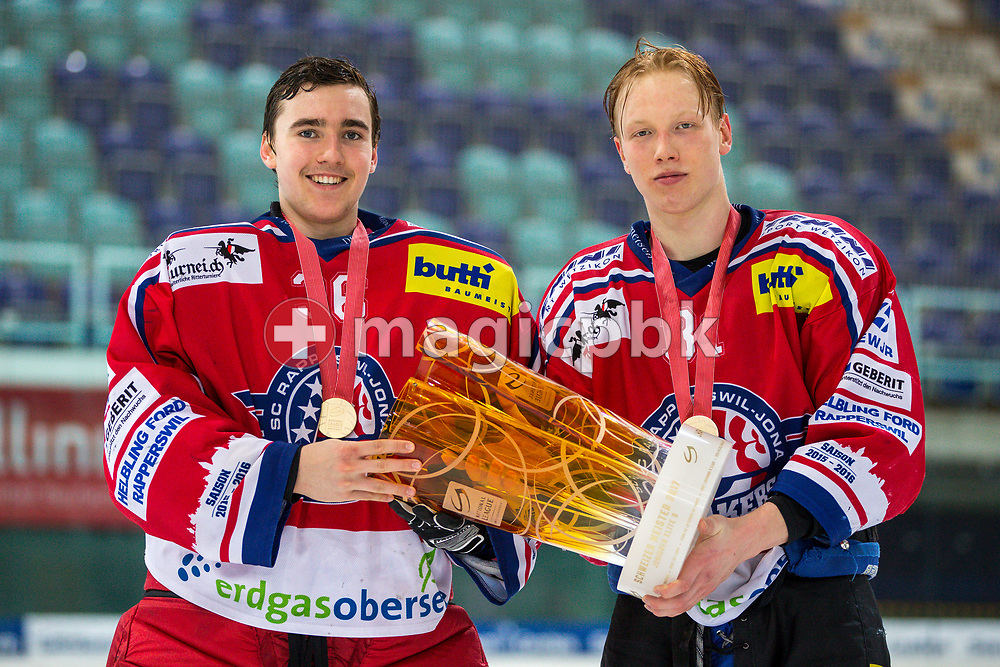 (L-R) Rapperswil-Jona Lakers goaltender Beat Trudel and forward Ryhor Ustsimenka pose for a photo with their gold medals and the Swiss Champion trophy after winning the fifth Elite B Playoff Final ice hockey game between Rapperswil-Jona Lakers and ZSC Lions held at the SGKB Arena in Rapperswil, Switzerland, Sunday, Mar. 19, 2017. (Photo by Patrick B. Kraemer / MAGICPBK)