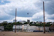 'Out of Tune' by AK Dolven, a sound installation on the 21st of May 2020 on the seafront in Folkestone, United Kingdom. Originally commissioned for the Folkestone Triennial Art festival, A K Dolven's installation 'Out of Tune' features a sixteenth century tenor bell from Scraptoft Church in Leicestershire, which had been removed for not being in tune with the others. Itis suspended from a steel cable strung between two 20m high steel beams, placed 30m apart. The bell was cast by Hugh Watts in the seventeenth century in Leicester. The Watts family were the leading bell founders in that city in the early 17th century. In all, they were responsible for almost two hundred castings for churches in the county. Hugh Watts prospered and was the Mayor of Leicester when King Charles 1st visited the city in 1634. (photo by Andrew Aitchison / In pictures via Getty Images)