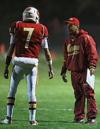 Marion head coach Tony Perkins (right) talks with quarterback Trevor Hardman (7) during the first half of the game between the Solon Spartans and the Marion Indians at Thomas Park Field in Marion on Friday evening, October 5, 2012.