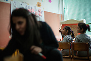 Romina Kajtazova - working as a paralegal for NGO Kham -teaching a workshop related to Roma health issues in a kindergarden located in the city of Vinica in Macedonia during  the European Immunization Week. In the back the twin daughters of one of the Roma participants.