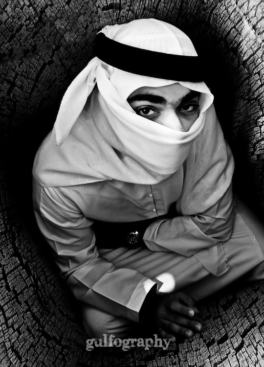 """""""Where is the Exit?"""" by Reem Al Falahi. Arab man with his face covered and enclosed by walls that surround him."""