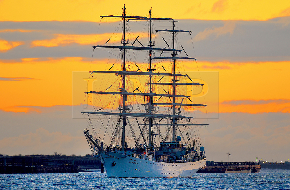 © Licensed to London News Pictures. 17/04/2019. London, UK. Polish tall ship Dar Mlodziezy (The Gift of the Youth) sails the Thames for Greenwich at first light. The tall ship has just completing a circumnavigation of the globe with her final port of call in Greenwich, London. The epic voyage of the Polish sail training vessel was to celebrate the 100th anniversary of Poland regaining independence. Dar Mlodziezy will be in port for three days, The Captain and crew will be inviting members of the general public aboard for a tour of the ship. Photo credit: Fraser Gray/LNP