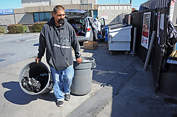 Ricardo Zamudio takes the family's recycling for redemption at the Exxon station on N. Main St. in Salinas.