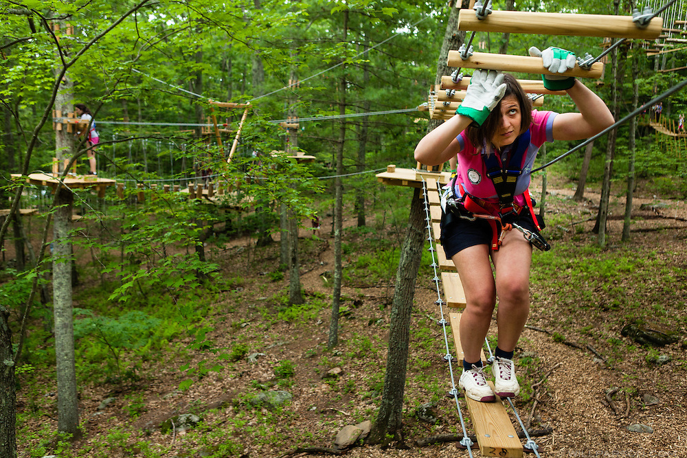 2013.06.16 - Storrs, CT - Alizee Deckmyn of New York City completes the Cedar Falls course at the Adventure Park at Storrs. The park, which opened in May, offers challenge courses of varying difficulty. Photograph by Will Parson | wparson@courant.com XMIT: B582980530Z.1
