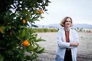 January 24th, 2012, Loma Linda, California. The health conscious residents of Loma Linda, a small California city with a large Seventh-day Adventist population, have banded together to fight against the opening of the town's first McDonald's. Pictured is nutritionist Dr. Sylvie Wellhausen, standing next to orange trees surrounding the site of the new McDonald's restaurant. PHOTO © JOHN CHAPPLE / www.johnchapple.com.