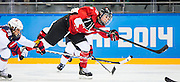 marie-Philip Poulin takes a shot as Canada takes on the USA in women's hockey action on February 12, 2014 at the Shayba Arena during the XXII Olympic Winter Games in Sochi, Russia.