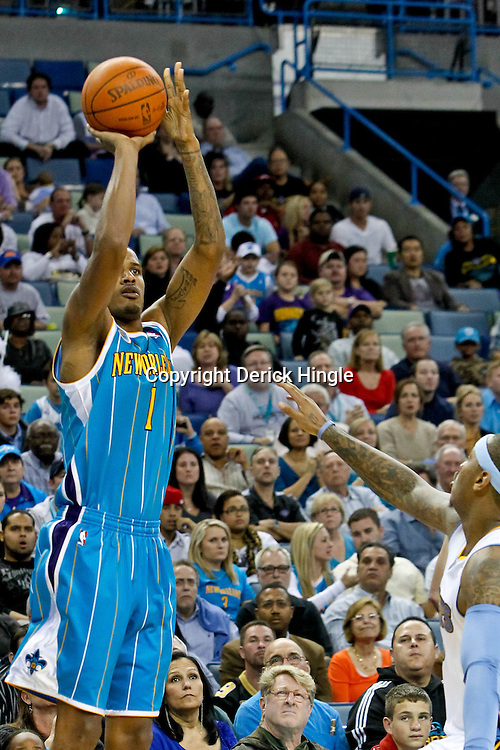 October 29, 2010; New Orleans, LA, USA; New Orleans Hornets small forward Trevor Ariza (1) shoots over Denver Nuggets small forward Carmelo Anthony (15) during the fourth quarter at the New Orleans Arena. The Hornets defeated the Nuggets 101-95.  Mandatory Credit: Derick E. Hingle