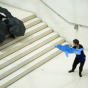 An oil slick made out of black umbrellas run down the steps in the Museum and a dolfin watches in horrow.  Reverend Billy and the art activist group Bp or not BP call out for the British Museum to stop accepting corporate sponsorship from the oil company BP at the British Museum and to an end to the use of fossil fuels.