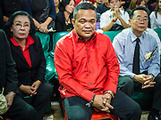 28 APRIL 2014 - BANGKOK, THAILAND: Red Shirt leaders, THIDA THAVORNSETH, left, JUTAPORN PROMPAN (center) and Dr. WENG TOJIRAKAM during the funeral for Kamol Duangphasuk, 45, in Bangkok. Kamol was a popular poet who wrote under the pen name Mai Nueng Kor Kunthee. Kamol had been writing since the 1980s and was an outspoken critic of the 2006 coup that deposed Thaksin Shinawatra. After the 2010 military crackdown against the Red Shirts he went into temporary self imposed exile fearing for his safety. After he returned to Thailand he organized weekly protests against Thailand's Lese Majeste laws, which he said were being used to stifle dissent. Kamol was shot and murdered on April 23. The assailants are still at large but the murder is thought to be political.     PHOTO BY JACK KURTZ