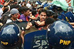 July 4, 2017 - Manila, Philippines - Protesters from different militant groups scuffle with anti-riot police as they march towards the Supreme Court in Manila on 04 July 2017. The protesters aired their sentiments as they await the decision of the Supreme Court regarding the petition against the declaration of martial law in Mindanao by President Duterte when the Marawi conflict erupted. The Court dismissed the petitions by a vote of 11 of its members. Three (3) voted to partially grant the petitions and one (1) member voted to grant the petitions. (Credit Image: © George Calvelo/NurPhoto via ZUMA Press)