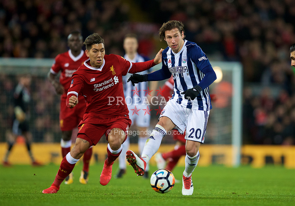 LIVERPOOL, ENGLAND - Sunday, January 14, 2018: Liverpool's Roberto Firmino and West Bromwich Albion's Grzegorz Krychowiak during the FA Premier League match between Liverpool and Manchester City at Anfield. (Pic by David Rawcliffe/Propaganda)