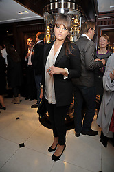 MOLLY MILLER MUNDY at a signing of Redeeming Features - Nicky Haslam's autobiography hosted by House & Garden magazine held at Ralph Lauren, Bond Street, London on 29th October 2009.