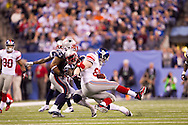 INDIANAPOLIS, IN - FEBRUARY 05:   Jake Ballard #85 of the New York Giants is tackled by  Brandon Spikes #55 of the New England Patriotsduring Super Bowl XLVI at Lucas Oil Stadium on February 5, 2012. (Photo by Tom Hauck)