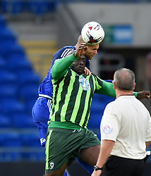Matthew Connolly of Cardiff City and Adebayo Akinfenwa of AFC Wimbledon compete to head the ball - Mandatory by-line: Paul Knight/JMP - Mobile: 07966 386802 - 11/08/2015 -  FOOTBALL - Cardiff City Stadium - Cardiff, Wales -  Cardiff City v AFC Wimbledon - Capital One Cup