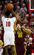 Center Reggie Lynch (22) reaches up to block the shot of Forward Nigel Hayes (10) during the first half of the University of Minnesota Men's Basketball game versus University of Wisconsin on March 5, 2017.