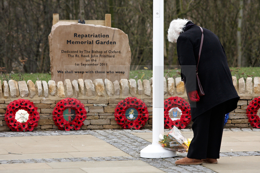 © Licensed to London News Pictures.  07/02/2012. CARTERTON, UK.A local resident  braves a bitterly cold day to pay their respects during the repatriation ceremony for Lance Corporal Gajbahadur Gurung from the Royal Gurkha Rifles, serving with 1st Battalion The Yorkshire Regiment, who was killed in Afghanistan on Friday 27 January 2012. He leaves behind his wife Manisha, father Gum Bahadur, mother Lekh Maya, his brother Buddha and sister Junu. Photo credit :  Cliff Hide/LNP