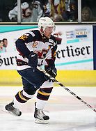 16 Jan 2010: Guildford, England. Jez Lundin of Guildford Flames attacks with the puck during the English Premier League match between Guildford Flames  Manchester Phoenix at Guildford (photo by Andrew Tobin/Slik Images)