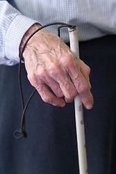 A man with his white stick at the Nottingham Royal Society for the Blind (NRSB),