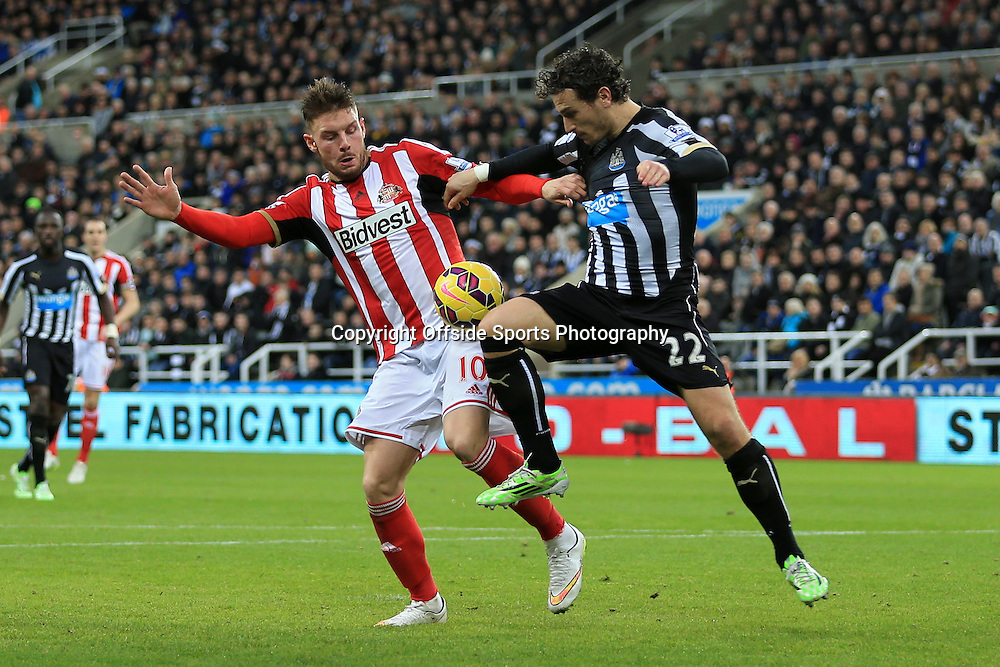 21st December 2014 - Barclays Premier League - Newcastle United v Sunderland - Connor Wickham of Sunderland battles with Daryl Janmaat of Newcastle - Photo: Simon Stacpoole / Offside.