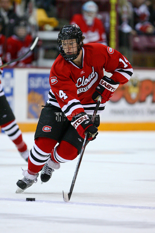 Oct 22, 2010; Minneapolis, MN, USA; St. Cloud State defenseman Nick Jensen (14) during the St. Cloud State Huskies 5-2 victory over the Minnesota Golden Gophers. Credit: Brace Hemmelgarn
