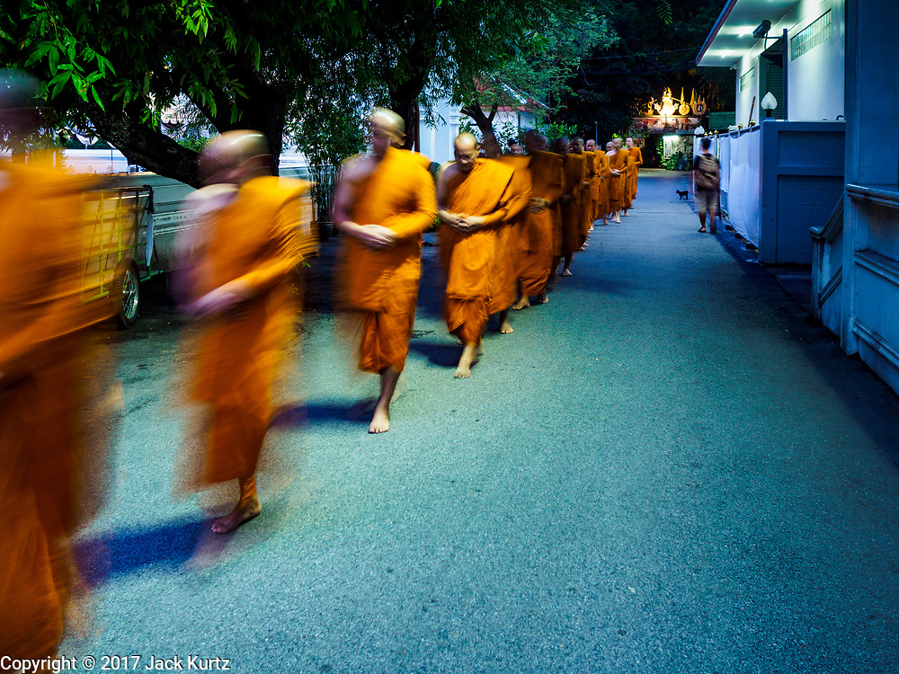 25 OCTOBER 2017 - BANGKOK, THAILAND: Buddhist monks walk into a prayer service for the king during the funeral for Bhumibol Adulyadej, the Late King of Thailand. He died in October 2016 and was cremated during an ornate five day funeral on 26 October 2017. He reigned for 70 years and was Thailand's longest serving monarch.         PHOTO BY JACK KURTZ