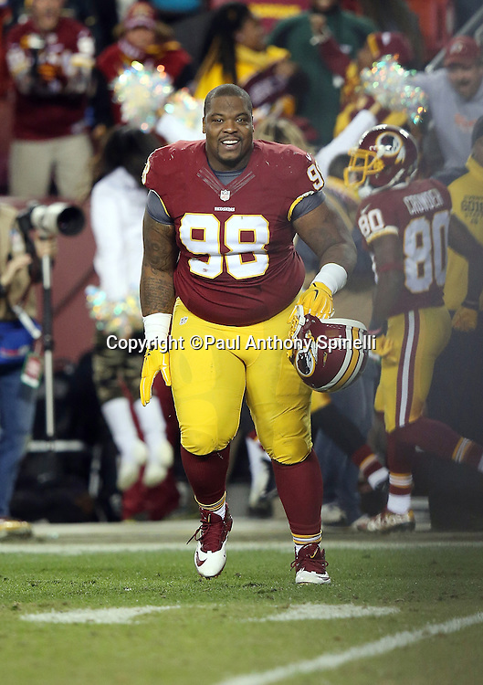 Washington Redskins defensive tackle Terrance Knighton (98) smiles as he runs onto the field during the 2015 week 13 regular season NFL football game against the Dallas Cowboys on Monday, Dec. 7, 2015 in Landover, Md. The Cowboys won the game 19-16. (©Paul Anthony Spinelli)