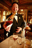 Sommelier Patrick Tamisier about to pour a glass of Champagne at the Restaurant Le Grand Vefour (Chef Guy Martin) in Paris - Photograph by Owen Franken