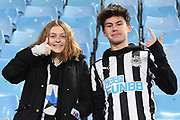 A girl and boy in Newcastle colours during the Premier League match between Aston Villa and Newcastle United at Villa Park, Birmingham, England on 25 November 2019.