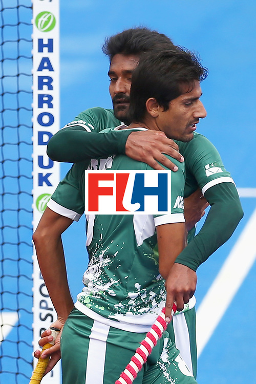 LONDON, ENGLAND - JUNE 25: Muhammad Irfan Jr. of Pakistan celebrates scoring his sides third goal with his Pakistan team mate during the 7th/8th place match between Pakistan and China on day nine of the Hero Hockey World League Semi-Final at Lee Valley Hockey and Tennis Centre on June 25, 2017 in London, England.  (Photo by Steve Bardens/Getty Images)