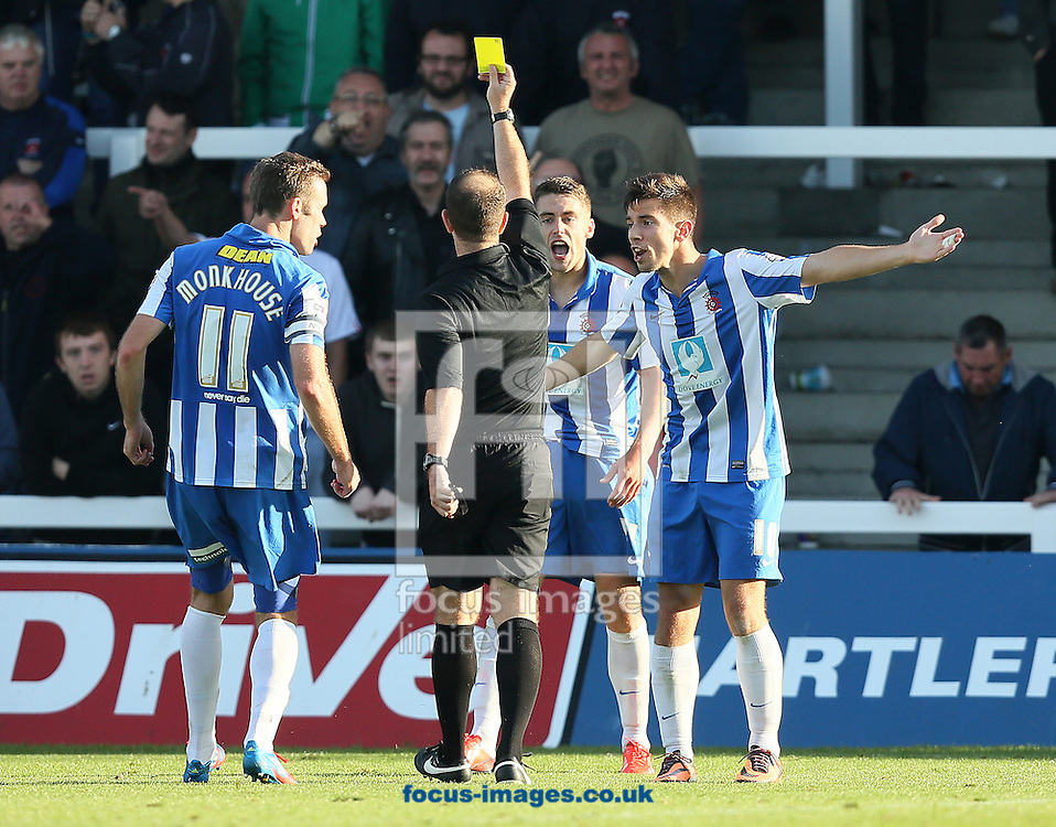 Picture by Paul Gaythorpe/Focus Images Ltd +447771 871632<br /> 28/09/2013<br /> Hartlepool United players protest as Jack Compton is booked by referee J Simpson for diving during the Sky Bet League 2 match against Oxford United at Victoria Park, Hartlepool.