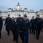 Police follow a small group of students through Horse Guard parade and St James' Park. Thousands of students turned out to a march against fees and cuts in the education sector, calling for workers and students to unite against the Government's austerity policies.