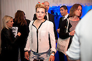 GEORGIE OKELL, Celebration of 10 years with Kate Moss as the face of the make-up brand Rimmel.  Battersea Power Station. London. 15 September 2011<br /> <br /> <br />  , -DO NOT ARCHIVE-© Copyright Photograph by Dafydd Jones. 248 Clapham Rd. London SW9 0PZ. Tel 0207 820 0771. www.dafjones.com.