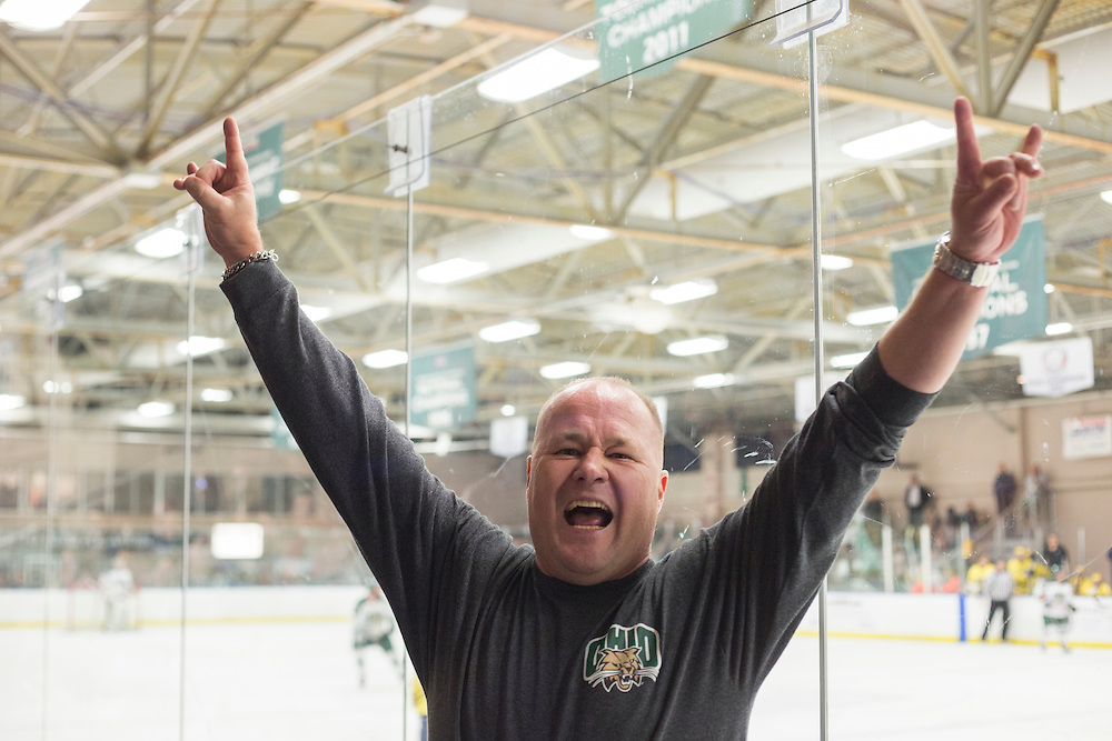 Mike Shuba, of Cleveland, cheers during the Ohio University vs. University of Michigan - Dearborn hockey game during Dad's Weekend on November 5, 2016. Shuba won the first ever Fan of the Game for his enthusiasm.