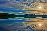 Clouds at sunrise reflected in Winnipeg River<br />Kenora<br />Ontario<br />Canada