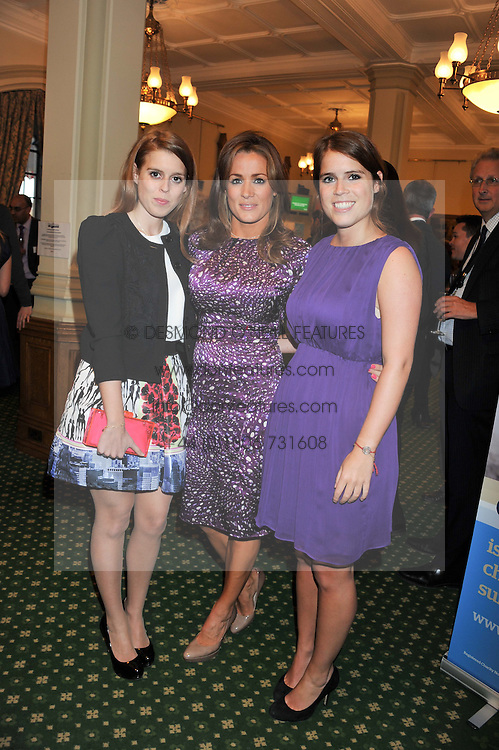 Left to right, PRINCESS BEATRICE OF YORK, NATALIE PINKHAM and PRINCESS EUGENIE OF YORK at a reception for The Mirela Fund in partnership with Hope and Homes for Children hosted by Natalie Pinkham in The Churchill Room, House of Commons, London on 30th April 2013.