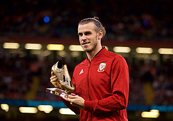 CARDIFF, WALES - Thursday, October 11, 2018: Wales' Gareth Bale with a golden boot awarded for being Wales' men's leading scorer during the International Friendly match between Wales and Spain at the Principality Stadium. (Pic by David Rawcliffe/Propaganda)