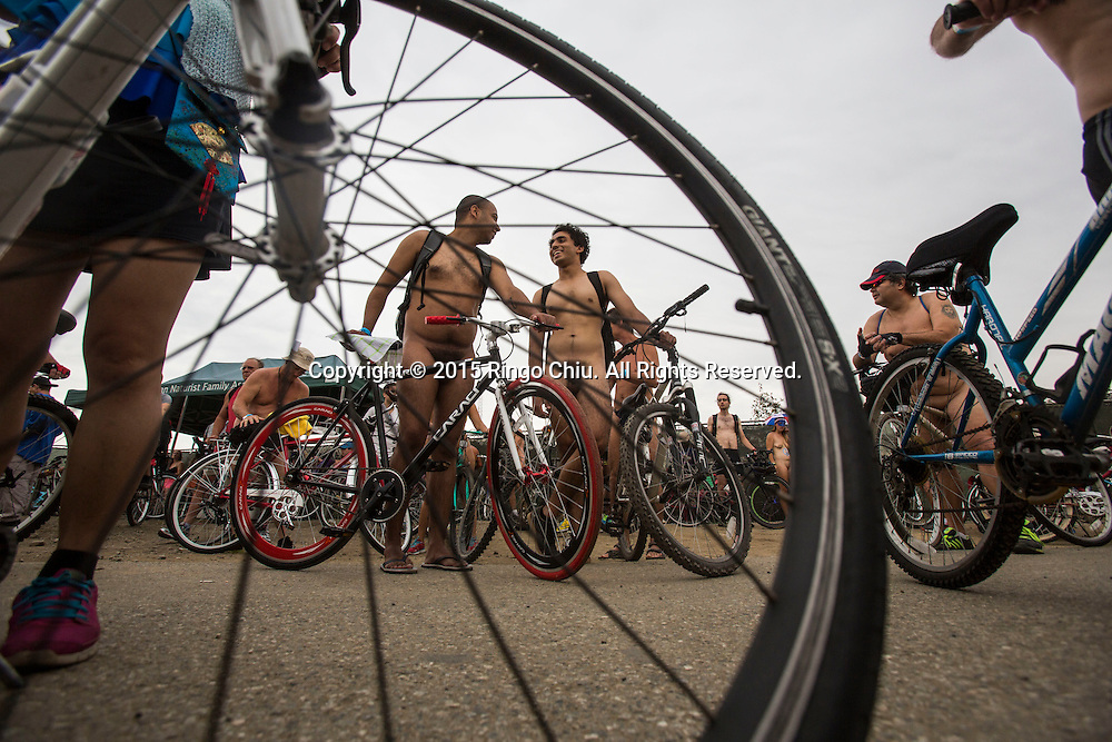 Participants prepare in the World Naked Bike Ride where nude cyclists ride through Downtown Lo Angeles on June 27, 2015 (Photo by Ringo Chiu/PHOTOFORMULA.com)